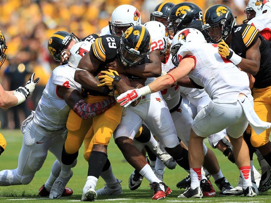 Iowa running back LeShun Daniels, Jr. gets brought down by a group of Illinois State defenders during their game at Kinnick Stadium on Saturday, Sept. 5, 2015.
