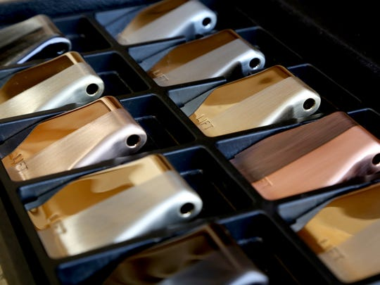 Seatbelt buckles in various colors are on display for