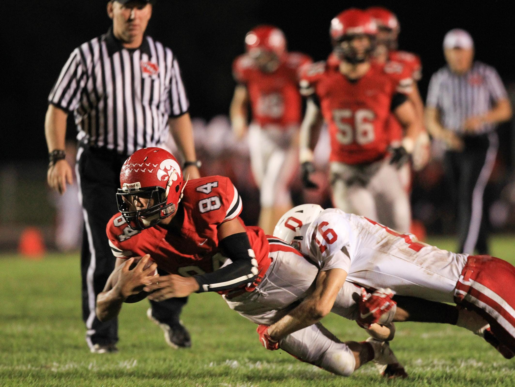 Ottumwa's Jalen Strunk tackles City High's Jason Jones during their game at City High on Friday, Sept. 25, 2015.