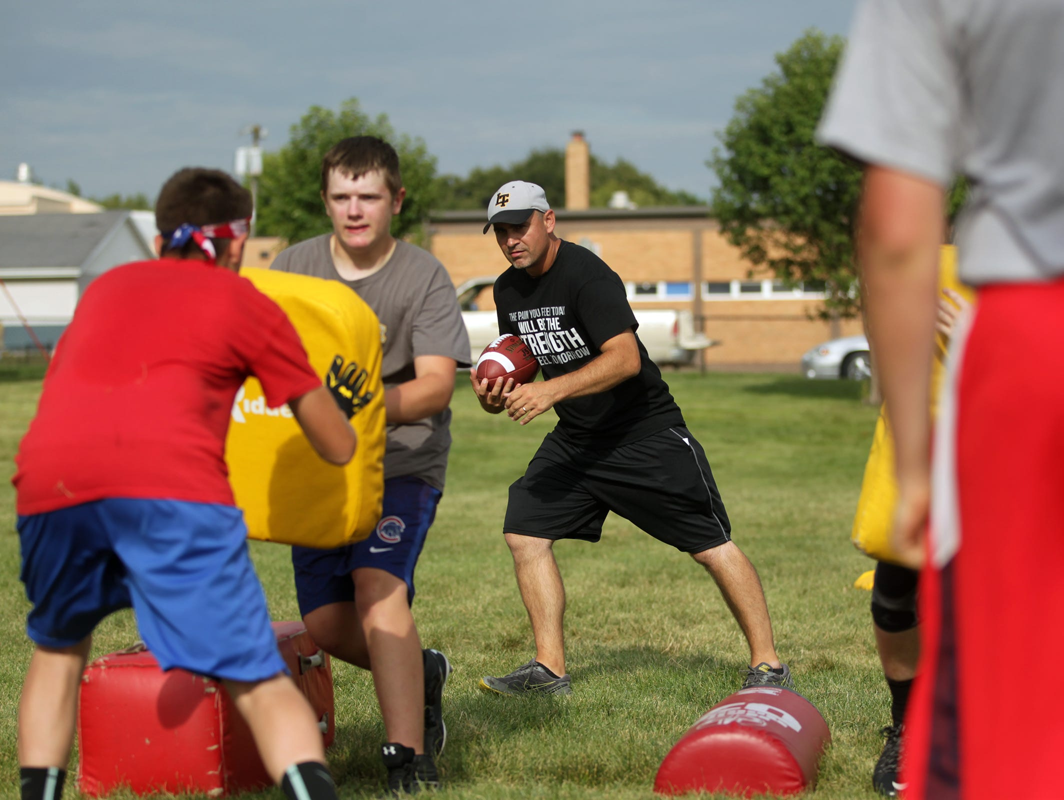 Lone Tree head coach Chad Shield works with his team on Thursday, Aug. 6, 2015. David Scrivner / Iowa City Press-Citizen