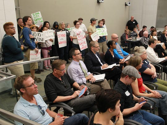 Community members gather as the Iowa City City Council