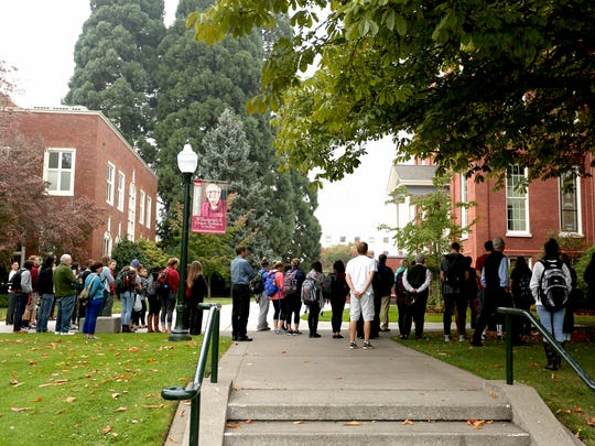 Students and staff gather for a moment of silence honoring the victims of last week's Umpqua Community College shooting at Willamette University in Salem on Thursday, Oct. 8, 2015.
