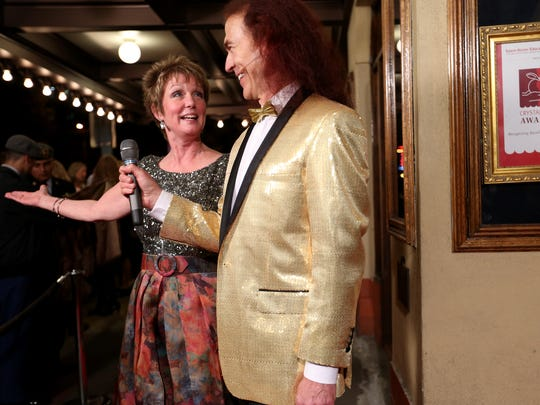 Krina Lee, the executive director of the Salem-Keizer Education Foundation, is interviewed by Ron Jaecks at the Salem-Keizer Education Foundation's 19th annual Crystal Apple Awards red carpet ceremony at the Elsinore Theatre in Salem on Thursday, Nov. 5, 2015.