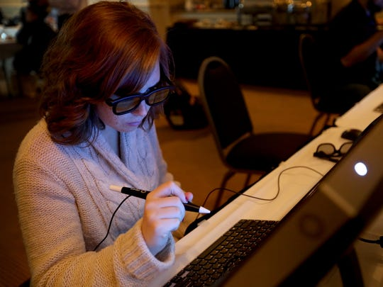 Statesman Journal education reporter Natalie Pate uses a desktop version of virtual reality technology during a presentation for Oregon educators about the possibilities of virtual reality technology in classrooms at the Grand Hotel in Salem on Monday, Nov. 9, 2015.