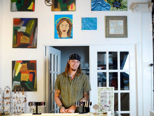 Dustin Nispel, one of three owners, stands inside The Rooted Artist Collective on North Newberry Street in York. The gallery will be open on Black Friday from 7 a.m. to  9 p.m.