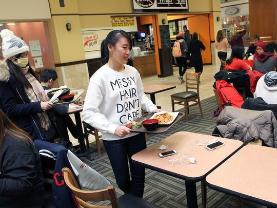 University of Iowa freshmen Ruijing Xiong, right, and