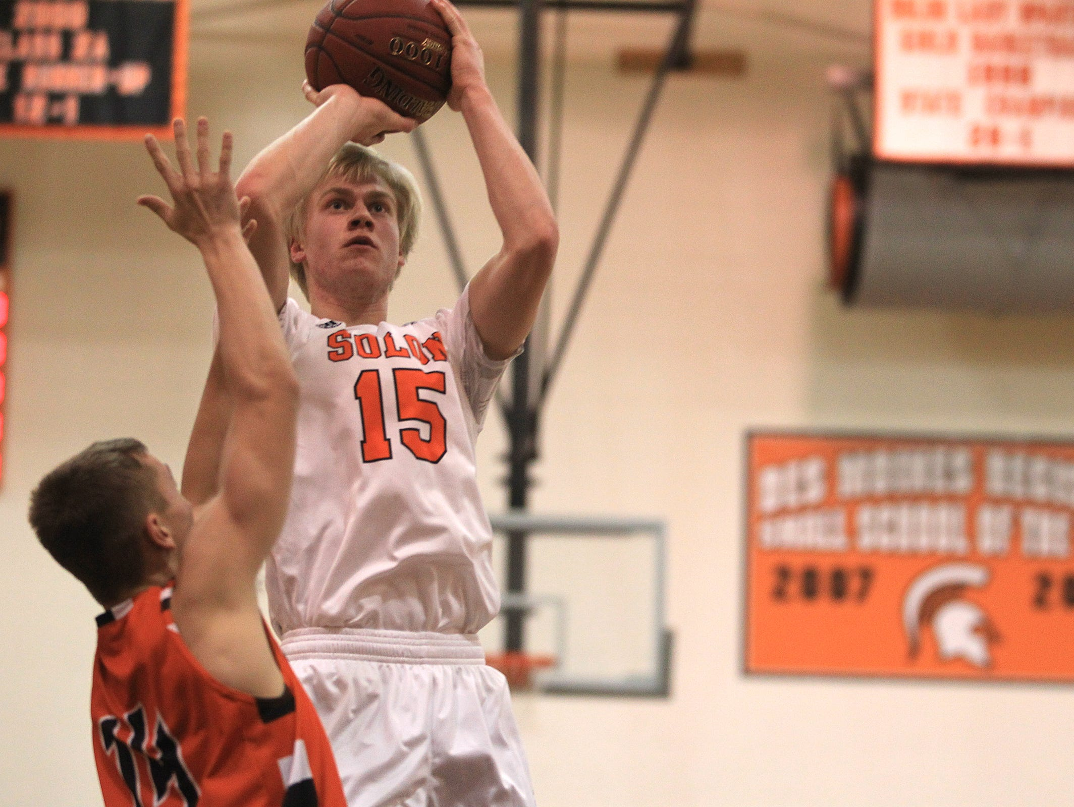 Solon's Streeter McIlravy goes up for a shot during the Spartans' game against West Delaware on Friday, Dec. 19, 2014.
