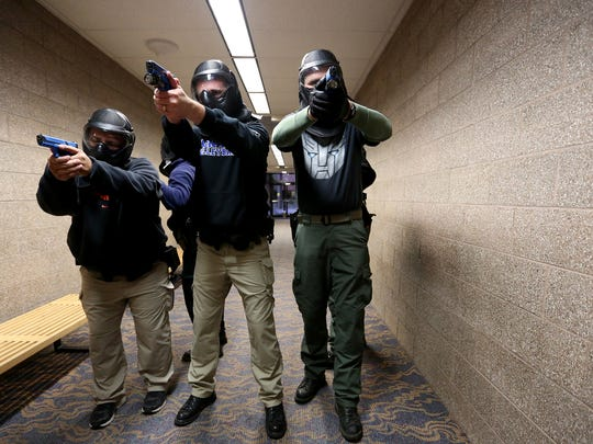 Officers stand in formation during an emergency response training for local law enforcement, led by the FBI, at Chemeketa Community College in Salem on Thursday, Dec. 17, 2015.