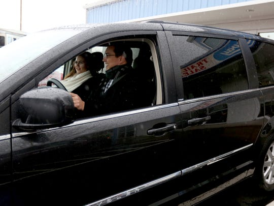 Employees of the Center for Hope and Safety drive off with a minivan donated to the center by Highway Trailer Sales and Service, after a request in the Statesman Journal Catalog of Giving, at Highway Trailer Sales and Service in Salem on Friday, Dec. 18, 2015.