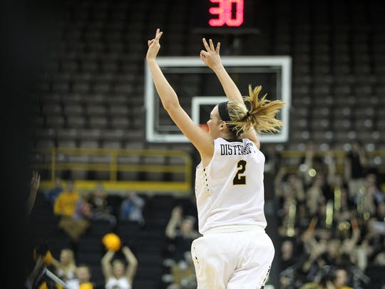 Iowa's Ally Disterhoft celebrates a Whitney Jennings 3-pointer during the Hawkeyes' game against Rutgers at Carver-Hawkeye Arena on Monday, Jan. 4, 2016.