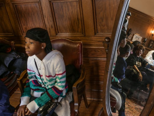 Kiona Henry, 9, of Grand Blanc waits for her turn to have blood samples taken to be tested for lead on Saturday, Jan. 23, 2016, at the Masonic Temple in downtown Flint.