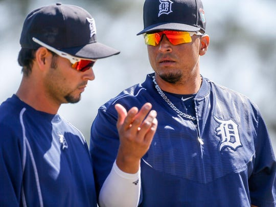 Anibal Sanchez, left, talks to Victor Martinez. Both Tigers veterans are trying to bounce back from injuries.