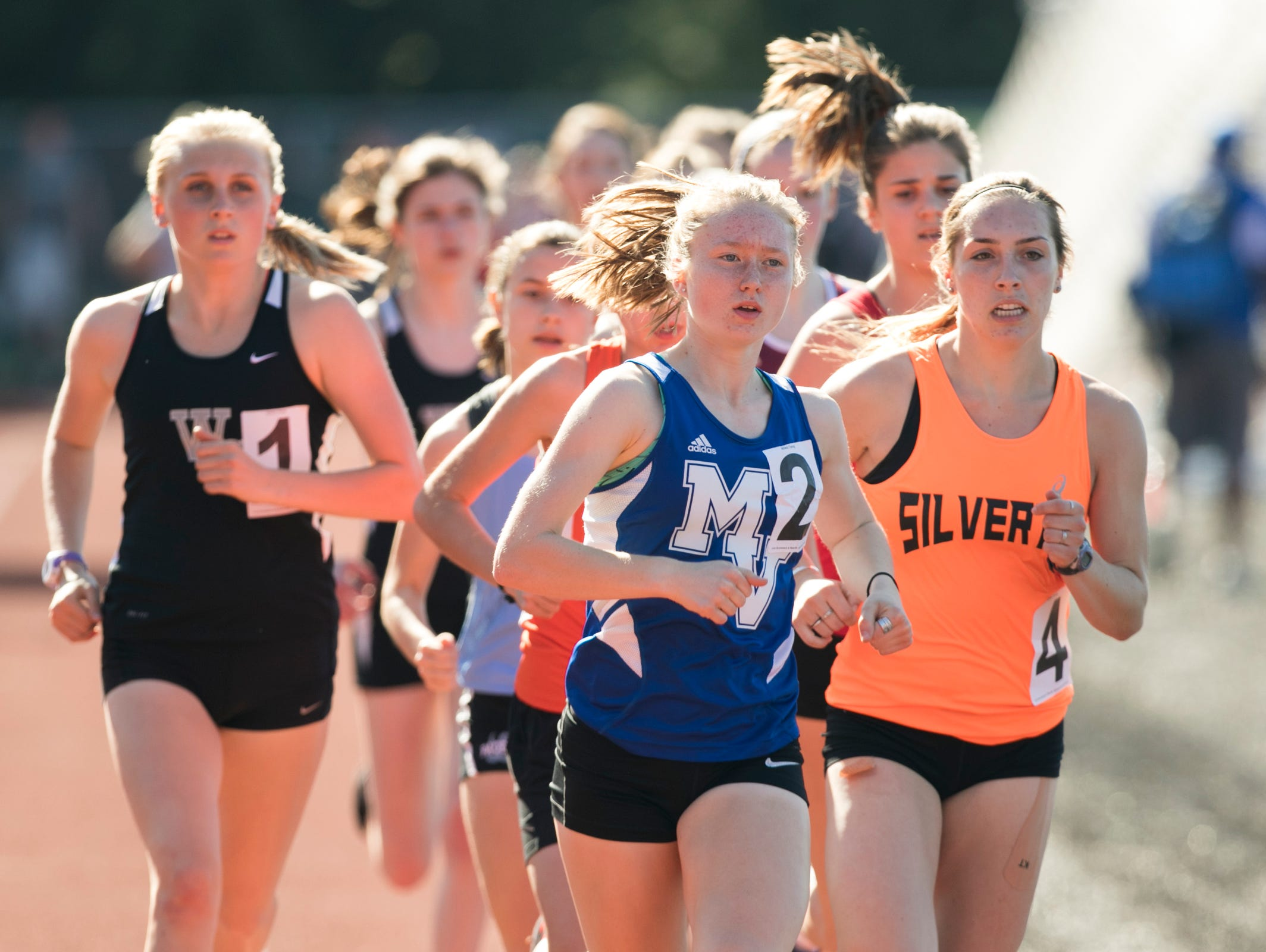 Mountain View's Savanna Craig leads the pack in the girls 1500 meter race at the Titan Track Classic at West Salem High School on Friday, April 1, 2016.