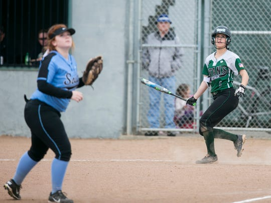 West Salem's Tayler Gunesch (1) and South Salem's Marissa Owen (24) watch a foul ball in a Greater Valley Conference softball game on Tuesday, April 12, 2016, at West Salem High School. West Salem shut out South 8-0 after seven innings and a game delay for rain.