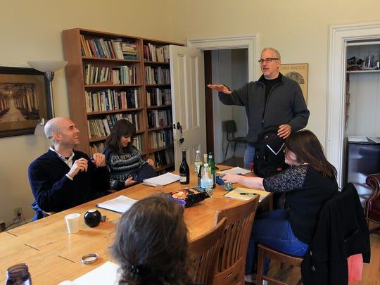 Ethan Canin chats with students in his fiction writing workshop at the Dey House on Tuesday, April 5, 2016.