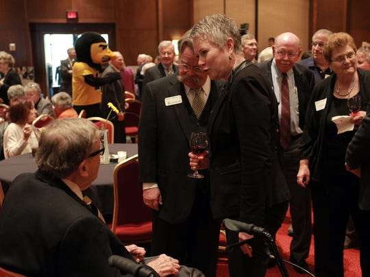 "Dr. Sarah Fisher Gardial, Dean of the University of Iowa Tippie College of Business, and her husband, Jeffrey Gleeson, greet former UI President Willard ""Sandy"" Boyd during a reception for him at the Coralville Marriott on Thursday, April 28, 2016."