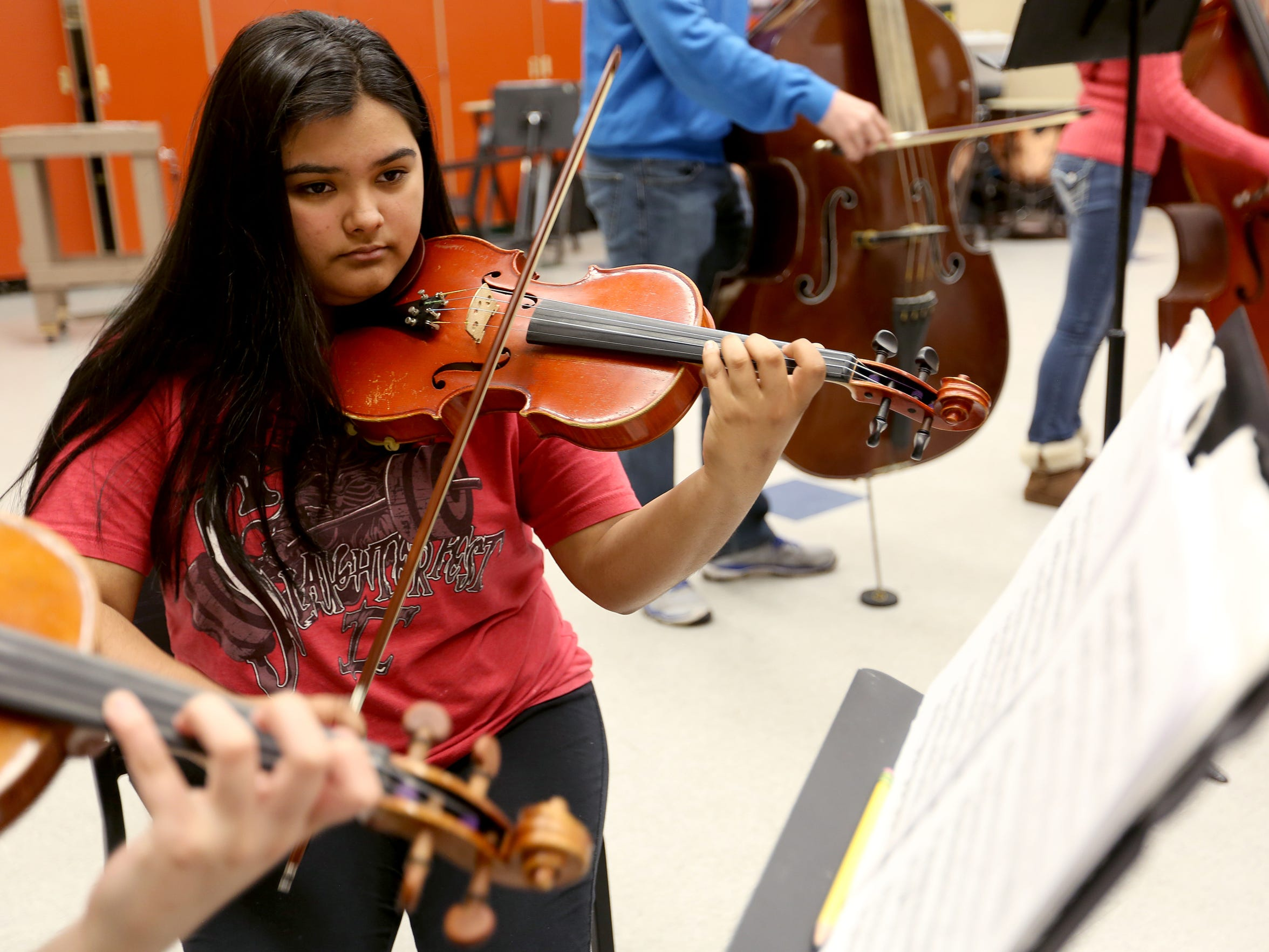 Celeste Moreno, a sophomore, plays first violin during chamber orchestra rehearsal at McKay High School in Salem on Thursday, April 14, 2016. McKay has a full symphony, with wind and strings, competing in the state music competition for the first time this year.