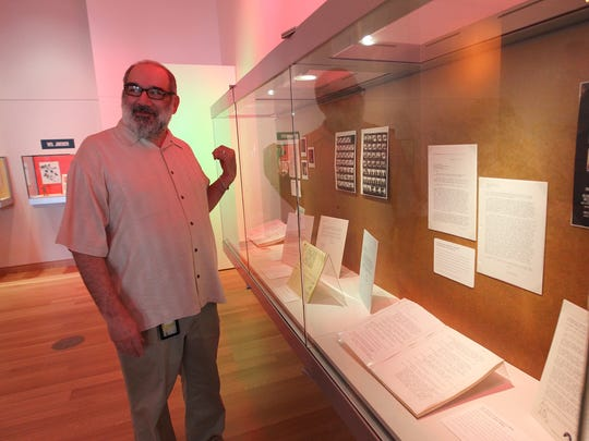 Peter Balesrtrieri, curator of science fiction and popular culture collections in for Special Collections, shows off some of his favorite Star Trek memorabilia at the University of Iowa Main Library's special exhibit on Wednesday, May 4, 2016.