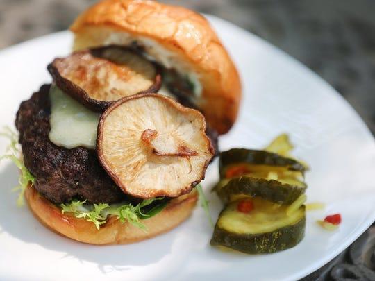 A Shitaki mushroom burger was prepared on the grill.