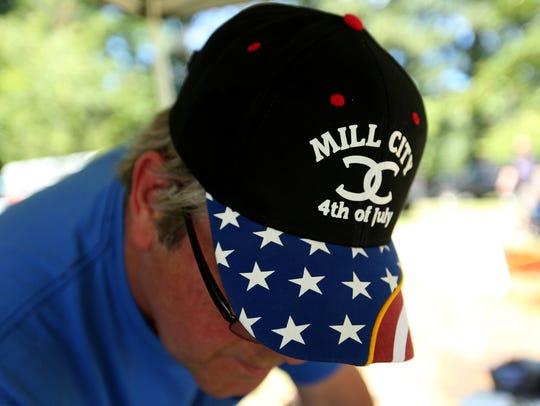 Paul Sydenstricker, of Gates, wears a patriotic cap