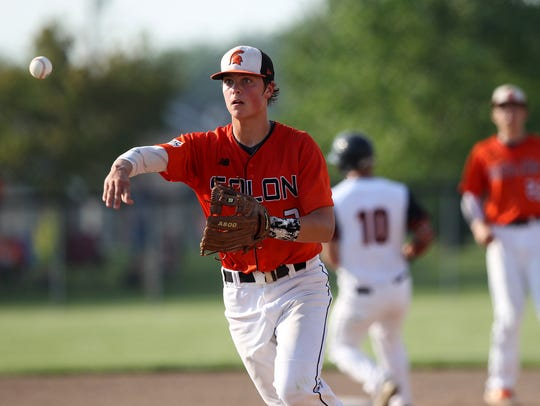 Solon's Peyton Bandy tosses the ball to first base
