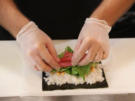 Rolling spicy tuna sushi, July 23, 2016.