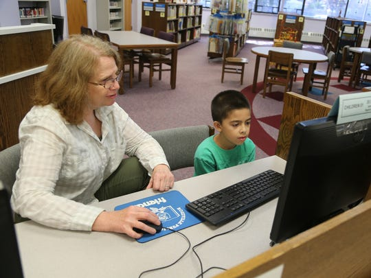 Margo Bowman and her grandson Matthew Bowman study at the Roseville Public Library on Tuesday, August 2, 2016 in Roseville.
