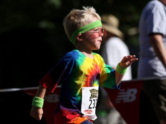 Hudson Stange, 6, of Monmouth, runs in the kid's 1K