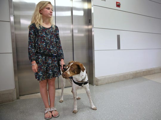 Gracie waits with Brystin Fleetwood for the elevator at Riley Hospital for Children at IU Health on Aug. 10, 2016.