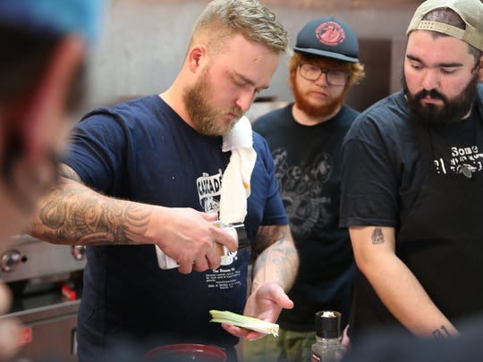 Rock City Eatery chef-owner Nikita Sanches, 31, demonstrates