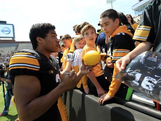Iowa wide receiver Jay Scheel signs autographs during