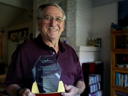 Ron Rubel stands for a photo after earning the Vern W. Miller Key Citizen Award for his volunteer work with the Center 50+. Photographed in Rubel's home in Salem on Thursday, Sept. 15, 2016.