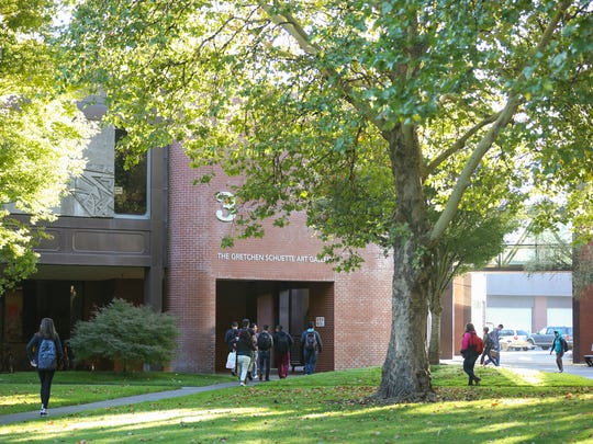 Students walk through campus on the first day of the fall semester in 2016.