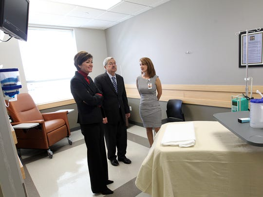 Iowa Gov. Terry Branstad and Lt. Gov. Kim Reynolds, left, tour the Iowa City Ambulatory Surgical Center on Thursday, Oct. 20, 2016.