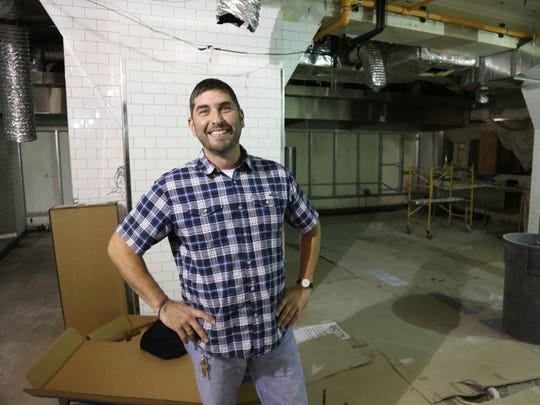 Restaurateur George Sboukis in the new, under-construction kitchen of downtown Detroit's Caucus Club restaurant, which he is reviving four years after it closed.