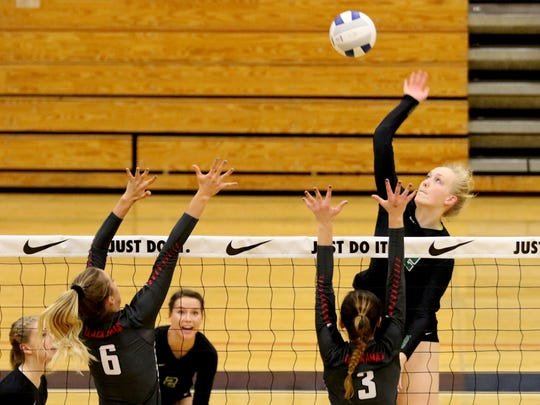 West Salem's Paige Whipple (12) spikes the ball past Clackamas' Calla Meyer (6) and Kayley Andersen (3) in the OSAA Class 6A quarterfinal volleyball match of Clackamas vs. West Salem at Liberty High School in Hillsboro on Friday, Nov. 4, 2016. West Salem lost in four sets.