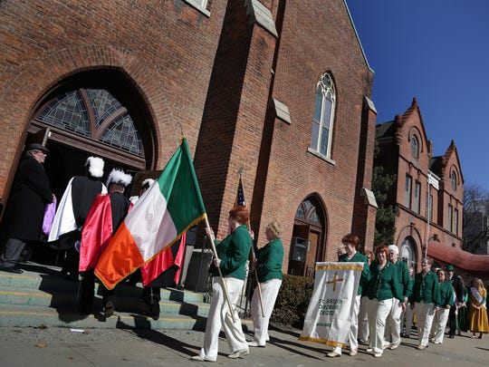 Before service for Saint Patrick Day celebration a procession enter the Church of The Most Holy Trinity in Corktown, Detroit on Tuesday, March 17, 2015.