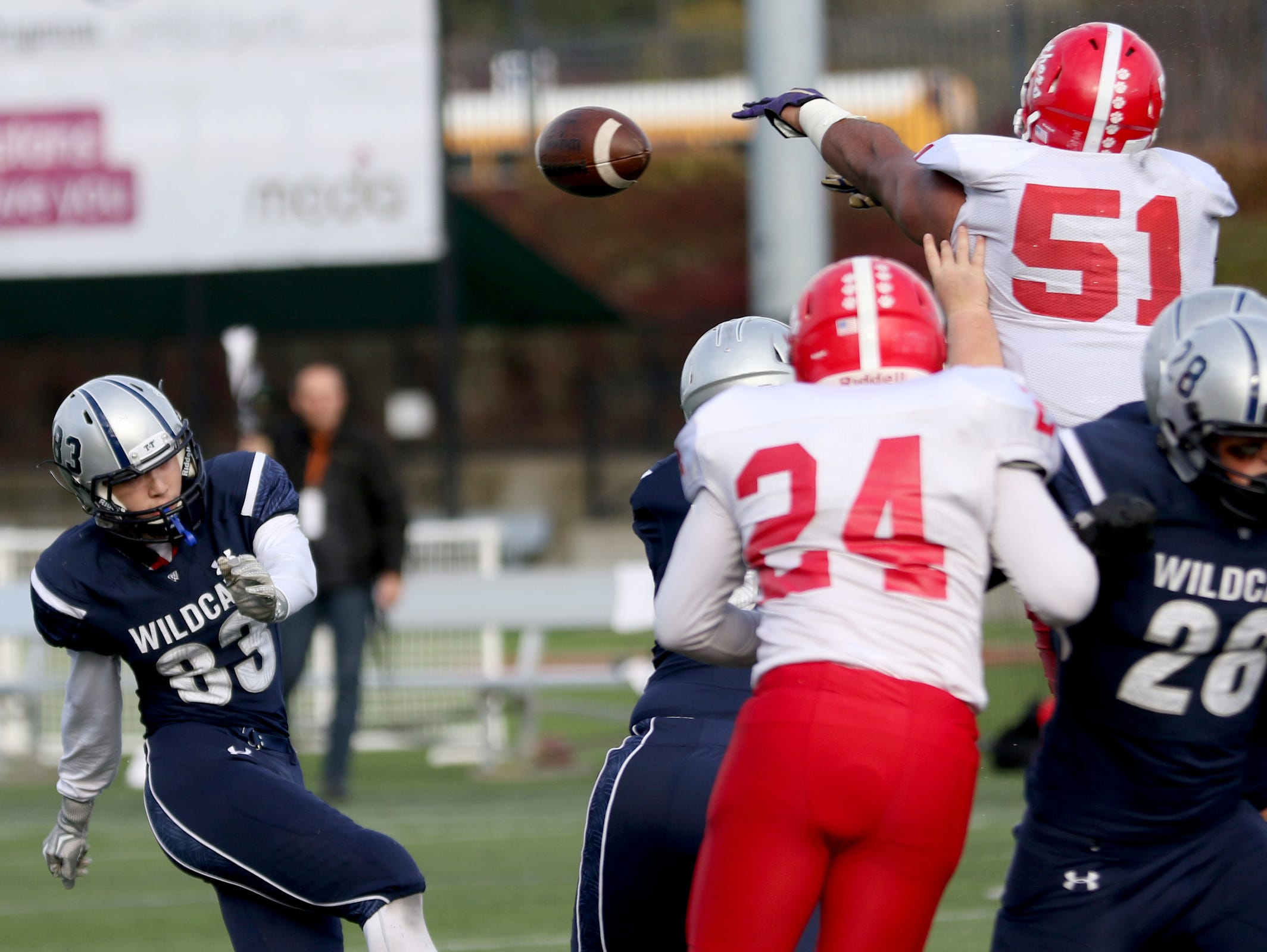 Central's Marlon Tuipulotu (51) blocks a Wilsonville field goal attempt in the second half of the Central vs. Wilsonville OSAA Class 5A semifinal football game at Hillsboro Stadium on Saturday, Nov. 19, 2016. Wilsonville won the game 56-34.