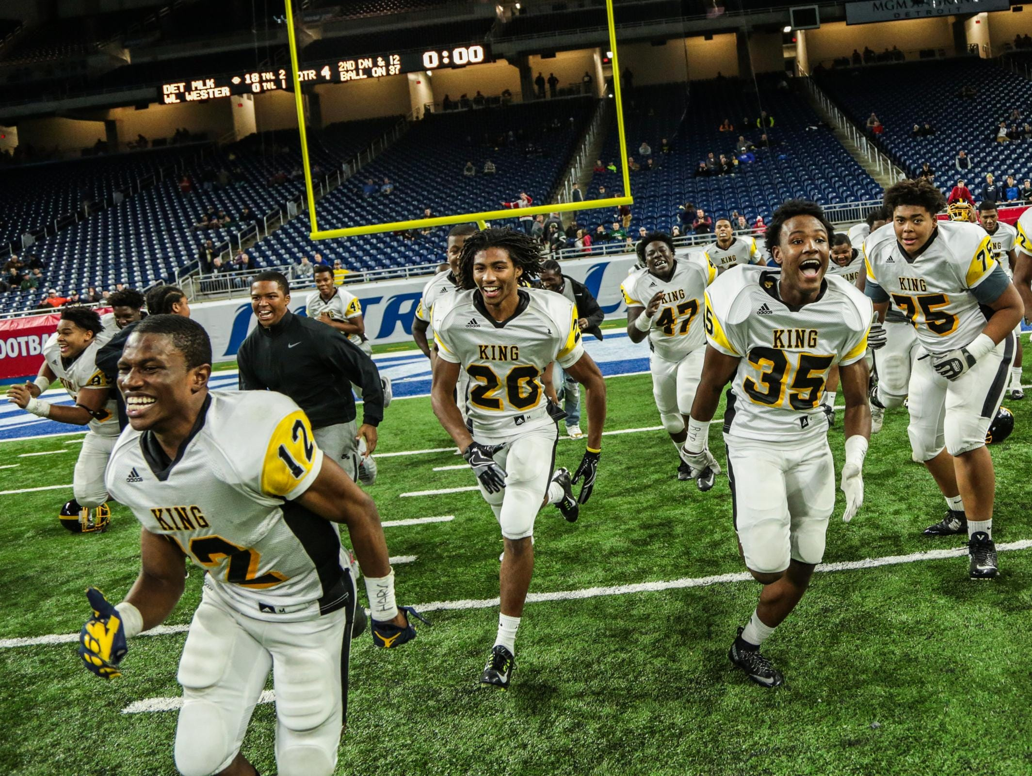 King defensive back Jesse Scarber, No. 12 celebrates with his teammates after winning the title against Walled Lake Western during Division 2 High School Championship game on Thursday November 24, 2016, at Ford Field in Detroit, MI.