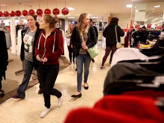Shoppers enter Macy's as it opens at 6 a.m. during Black Friday shopping at Salem Center on Friday, Nov. 25, 2016.
