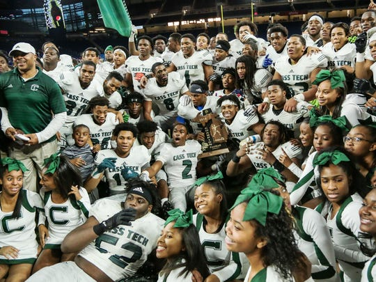 Detroit Cass Tech celebrates its third state title after a 49-20 win over Detroit Catholic Central.