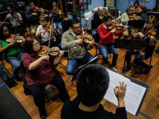 Members of the Detroit Community Orchestra play the violin with Hai-Xin Wu, DSO violin coach, during rehearsal on Tuesday November 29, 2016, at the Max M. Fisher Music Center in Detroit, MI. Detroit Symphony Orchestra started a community orchestra few months ago, an amateur ensemble comprised of adults who used to play an instrument and have them practice side-by-side with DSO musicians.