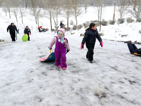 Children sled at Riverview Park in Independence on Thursday, Dec. 15, 2016.