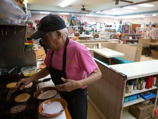 Jesse Lerma has been a cook for Hamlin Fountain and Gifts since 1960. Employees and customers held a party for Lerma, 76, on his 57th anniversary working for the one-time pharmacy. In this Dec. 19, 2016, photo, he prepares hamburgers during lunch service.