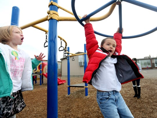 Kindergartner Tazayah Havranek, right, plays at recess at Stayton Elementary in Stayton, Ore., on Friday, Jan. 13, 2017. The North Marion School District needs to add more than two additional days of instructionsal time to make up for snow days taken this school year.
