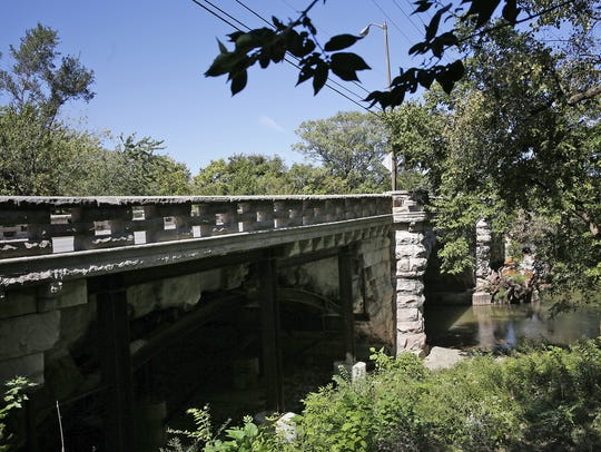The Central Avenue bridge over Fall Creek is pictured in September 2016, before it was closed for repairs. It is one of several crumbling historical bridges in the area that will be repaired or replaced.