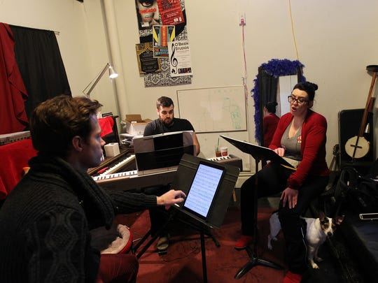 """Jack Cottrell, from left, Carl Rowles and Megan O'Brien rehearse a song for the Old Capitol Opera's performance of """"The Last Five Years"""" on Tuesday, Feb. 14, 2017."""