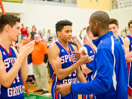 Spring Grove's Eli Brooks receives a YAIAA championship medal from his father and Spring Grove head coach James Brooks after the YAIAA boys basketball championship game at York College on  Feb. 13, 2016.