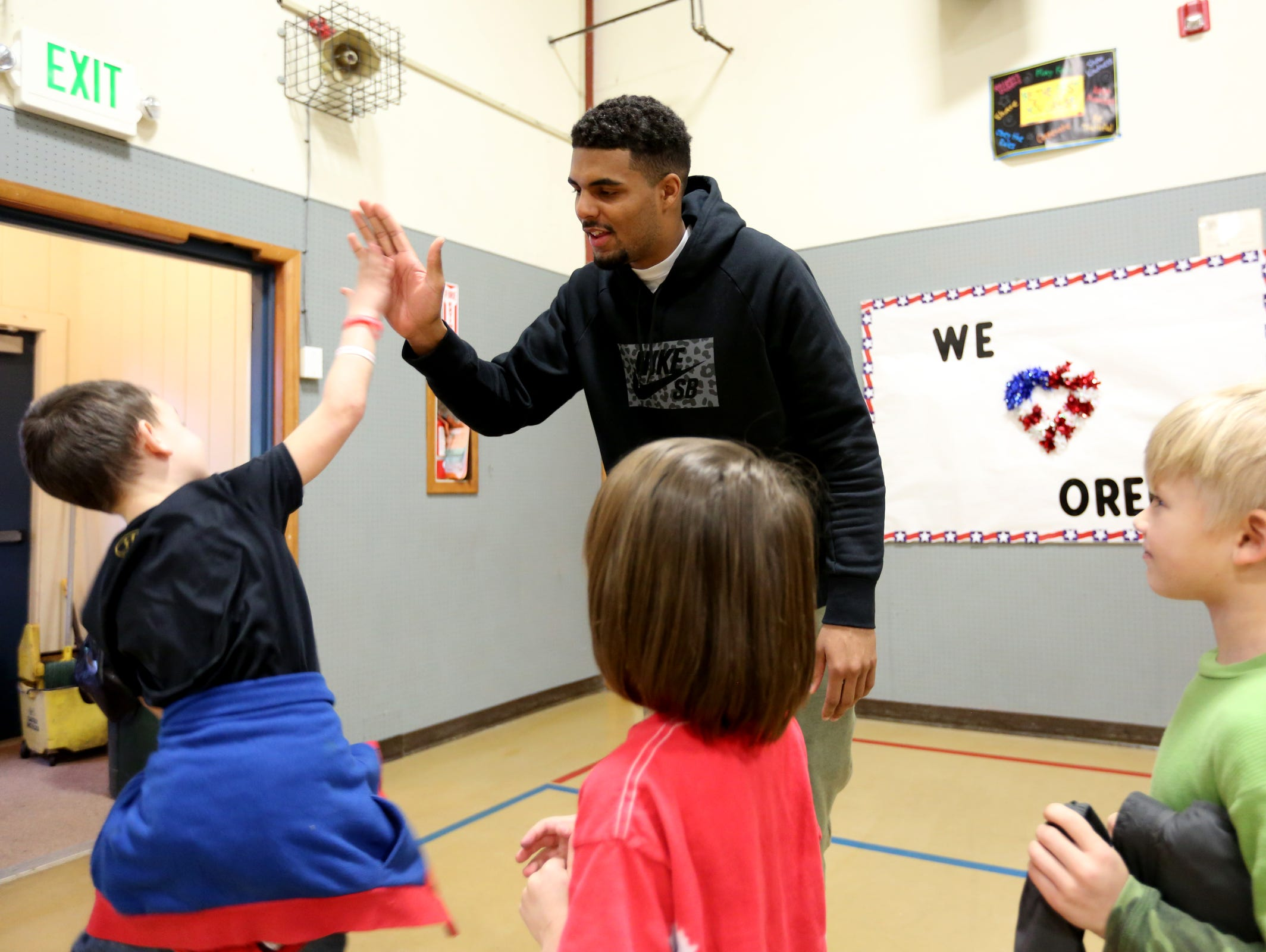Los Angeles Chargers wide receiver Tyrell Williams high-fives students at Turner Elementary School, where he attended fifth grade, on Tuesday, Feb. 21, 2017.