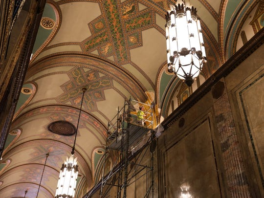 Allen Kehde works on repainting and repairing the water damaged ceilings in the arcade of the Fisher Building. Stencils are being made from existing areas to replicate the areas that were lost.